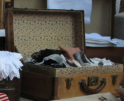 old suitcase with linens