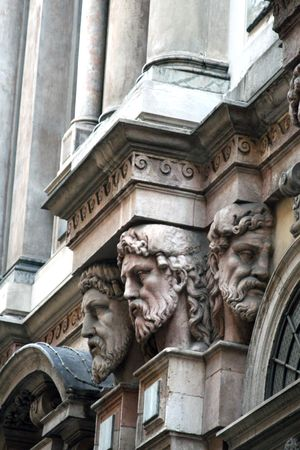 Carved faces milan