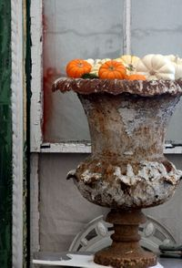 French antique urn with fall foilage
