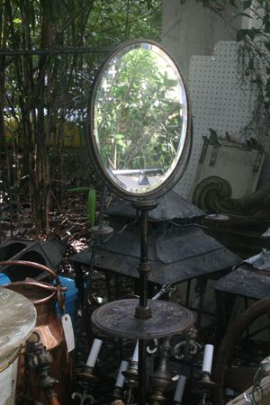 A mirror stand for a gentleman's shaving