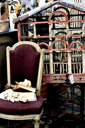 French antique bird house and aubergine chair