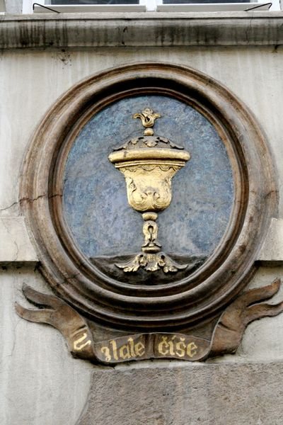 Chalice above doorway in Prague