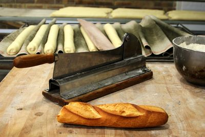 French bread cutter, at the bakery in France