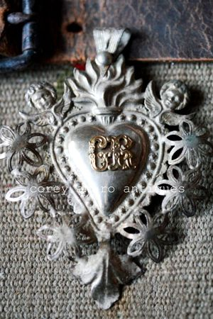 Ex voto heart with angels
