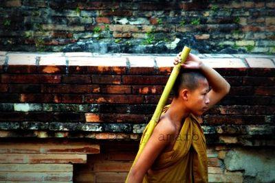 Buddhist monk with broom
