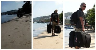 Carrying a suitcase on the beach