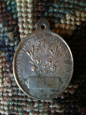 Oval medal Mary