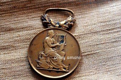 Harpist music medal