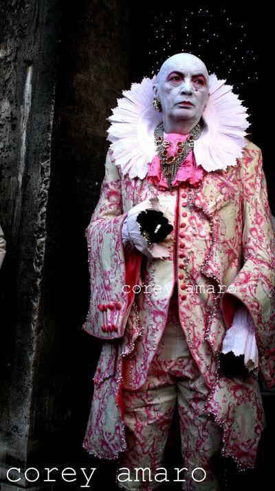 Man in pink venice carnival