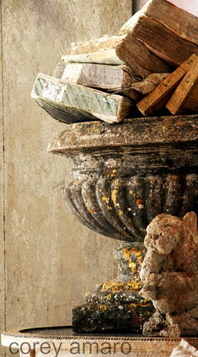 Stone urn full of old books