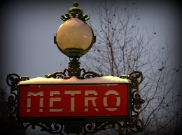 Paris Metro Sign in the snow, by Chelsea