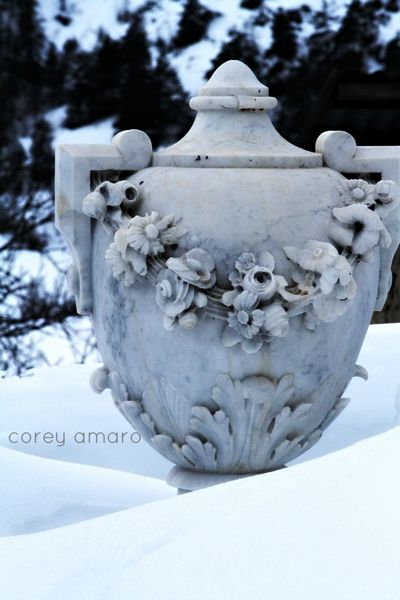 Marble urn in the snow
