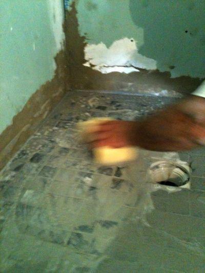 Sponging off tiles, France