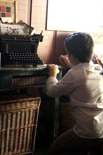Boy writes a letter