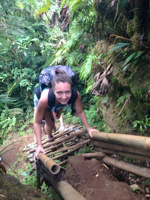 Going up bamboo ladder