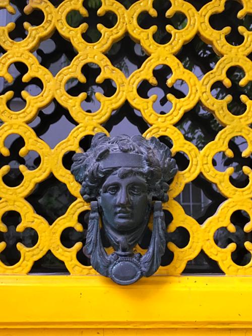 yellow door and knocker in Paris