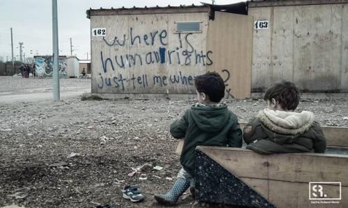 Sacha filming refugees